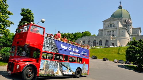 Red Hop On Hop off double-decker bus in front of St. Joseph's Oratory