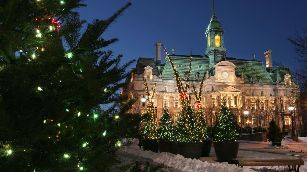 Montreal City Hall in winter with trees lighted for Christmas