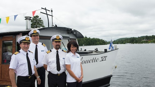 The crew posing in front of a boat on the Lac des Sables outside Montreal Canada