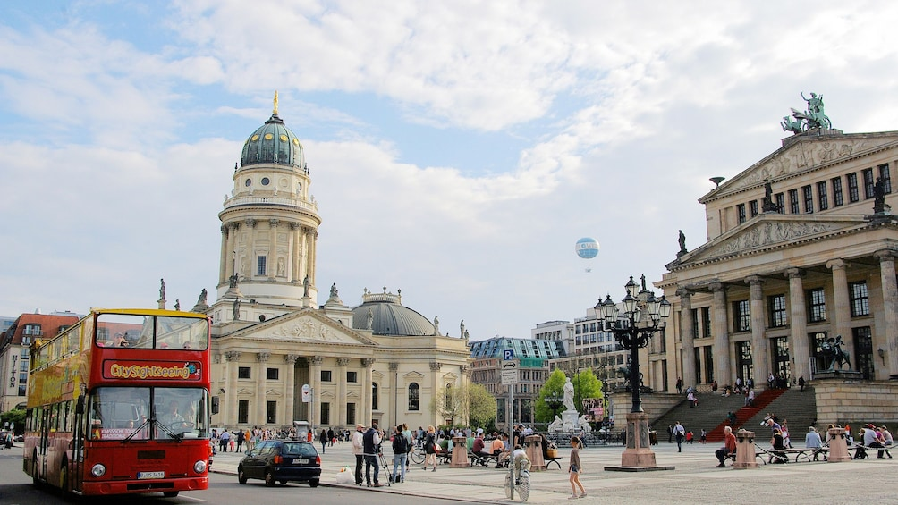 Cargar ítem 3 de 10. A hop on hop off bus driving past historical buildings in Berlin