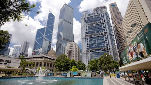 Water fountain amidst tall skyscrapers in Hong Kong