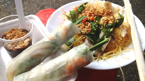 Spring rolls and a papaya salad dish on the Saigon Street Food Tour in Ho Chi Minh City