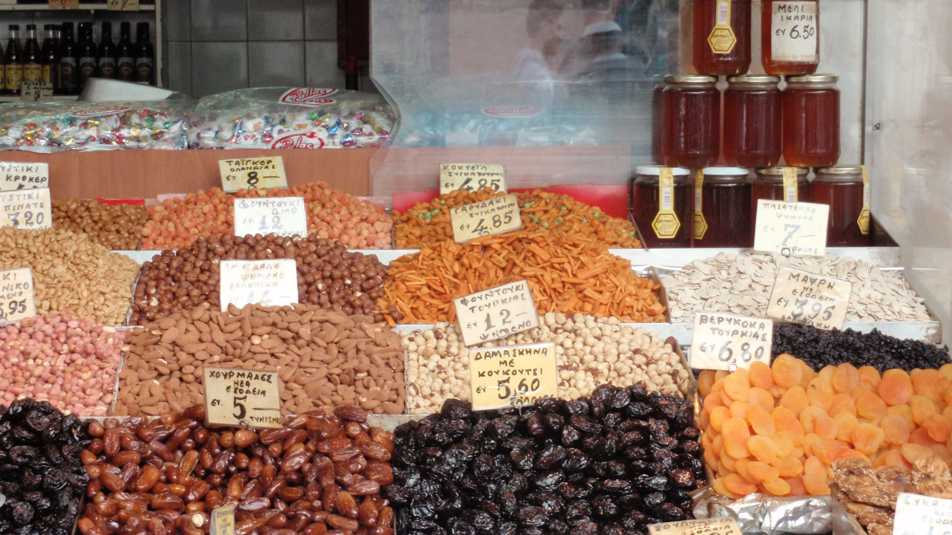 Bins of nuts at an open-air market in Athens