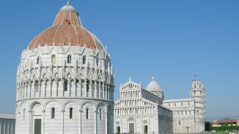 Show item 2 of 5. Red dome of the Baptistry with the Cathedral and Leaning Tower of Pisa in the background
