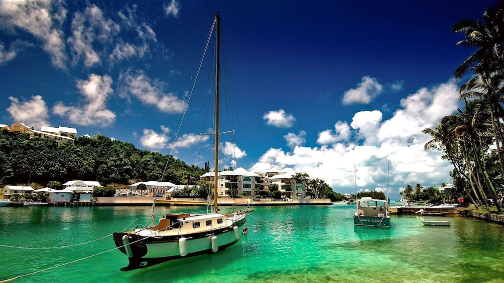Show item 3 of 5. Boats on the beautiful blue and green waters of Bermuda's East end