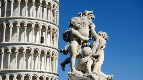 Leaning Tower and the Statue of Angels in Pisa