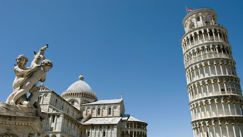 Pisa Square of Miracles with The Leaning Tower, Cathedral and Statue of Angels in Florence