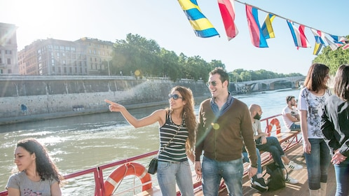 A couple aboard the boat on the Tiber River in Italy