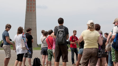 Tour group listening to a guide at Sachsenhausen