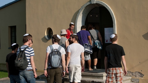 Tour group entering a building in Terezín Concentration Camp in Prague