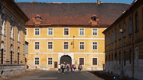 Tour group walking through the buildings of Terezín Concentration Camp in Prague