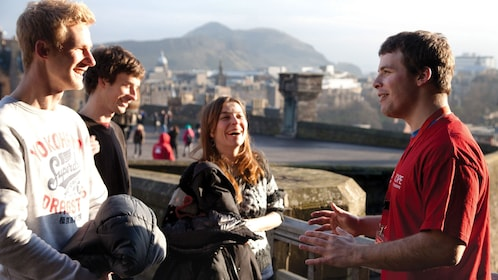 friends enjoying time at castle in edinburgh