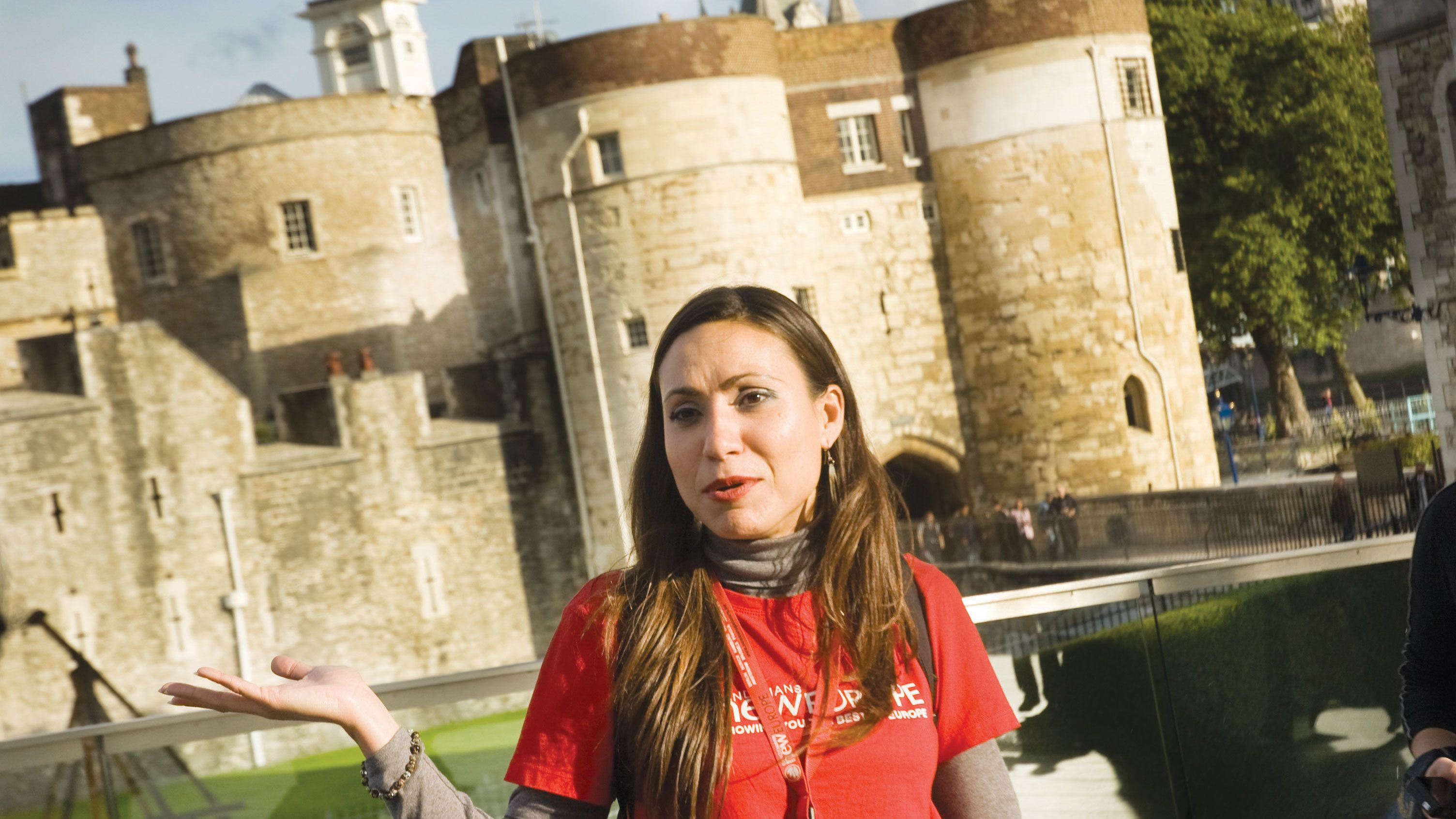 tour guide in front of lion tower of London