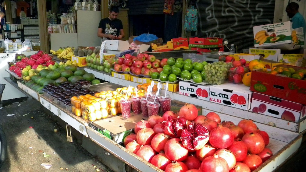 Show item 2 of 6. fresh produce at a market in Jerusalem