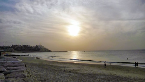 The sun setting over a beach in Jerusalem