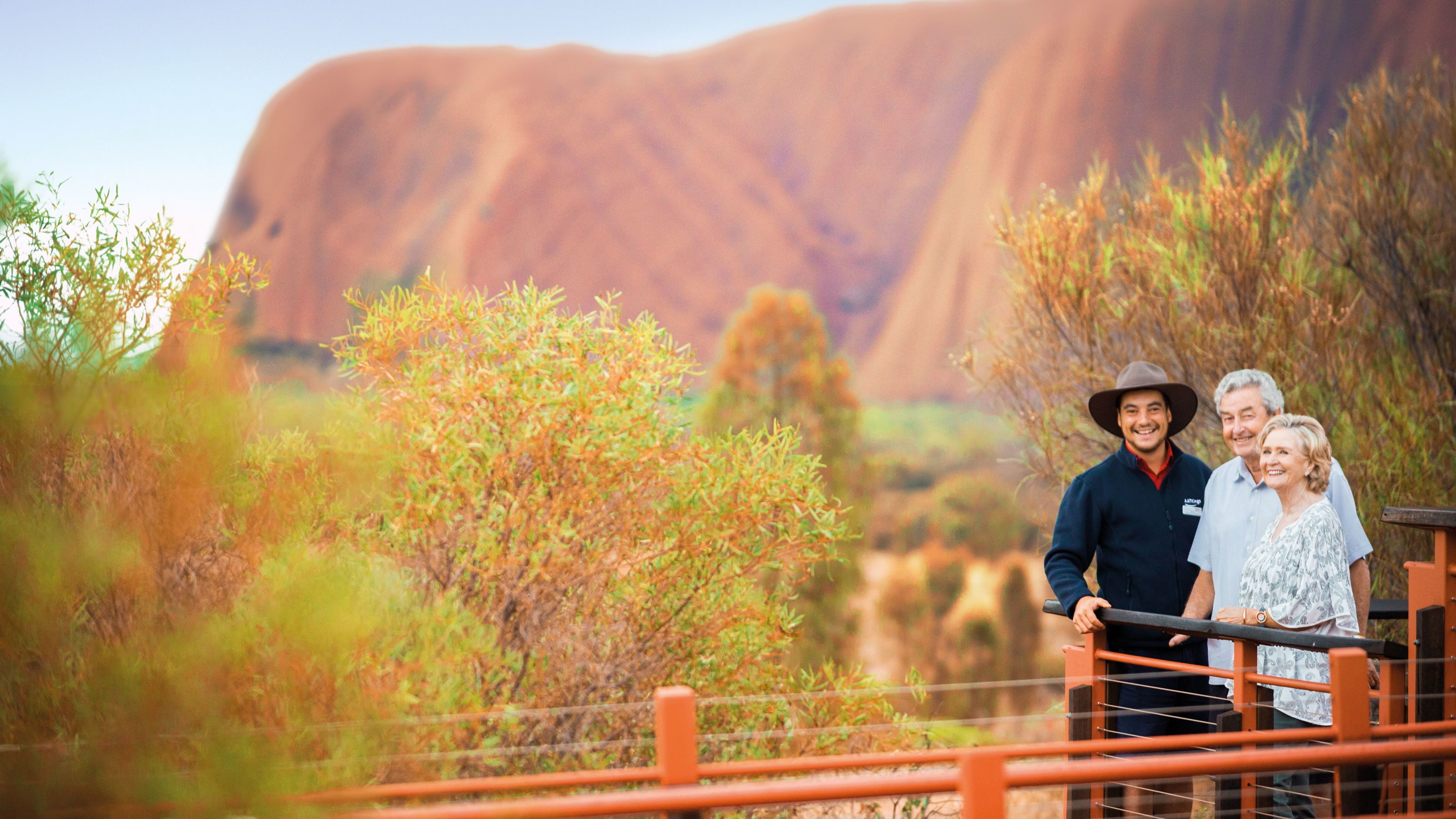 Couple with tour guide at Uluru National Park in Central Australia