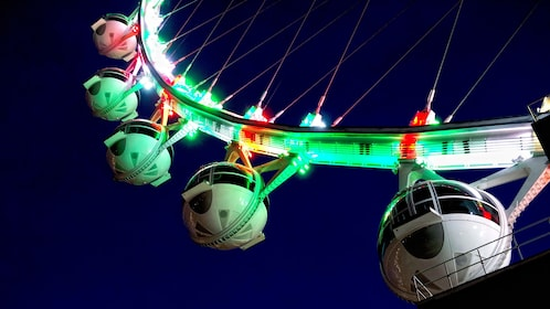 Close up of The High Roller Observation Wheel at night with neon lights in Las Vegas