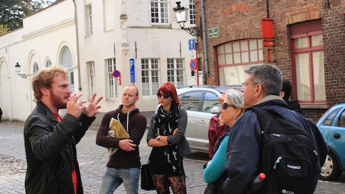 Tour group listening to their tour guide on a tour of Bruges
