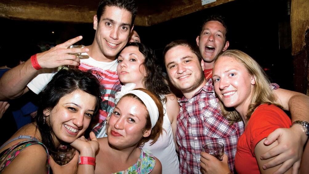 Foto 2 van 5. Group smiling inside a pub in Brussels