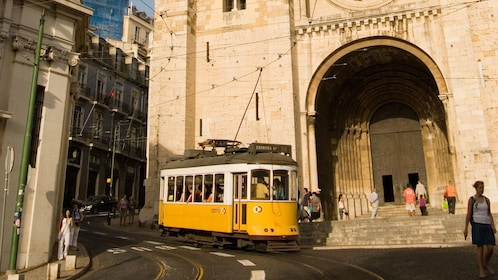 city tram outside of the Lisbon Cathedral in Portugal
