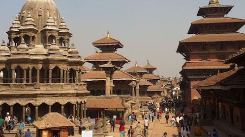 People walking past historic buildings in Bhaktapur