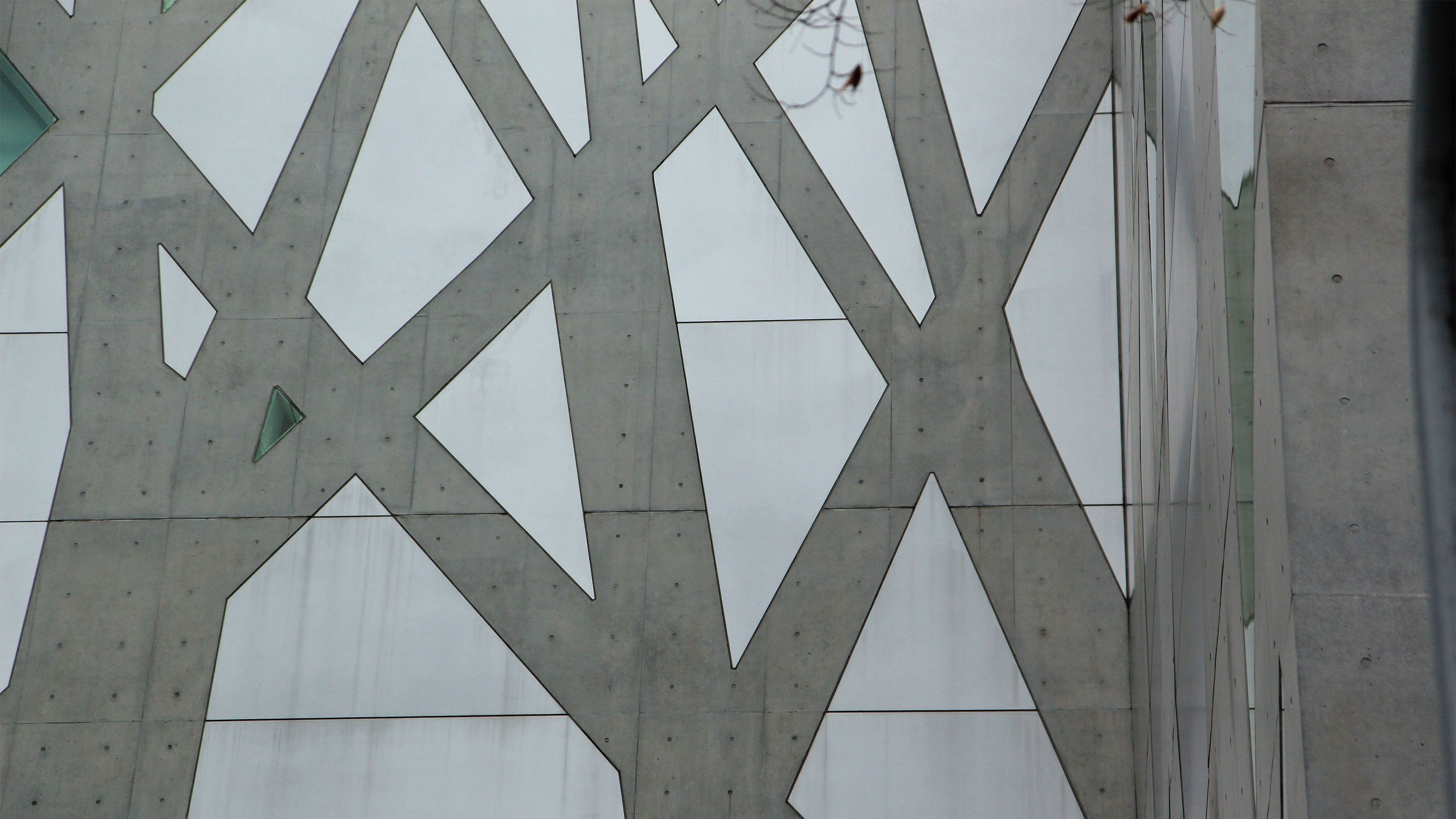 Detail of a geometric design on the side of a skyscraper in Tokyo