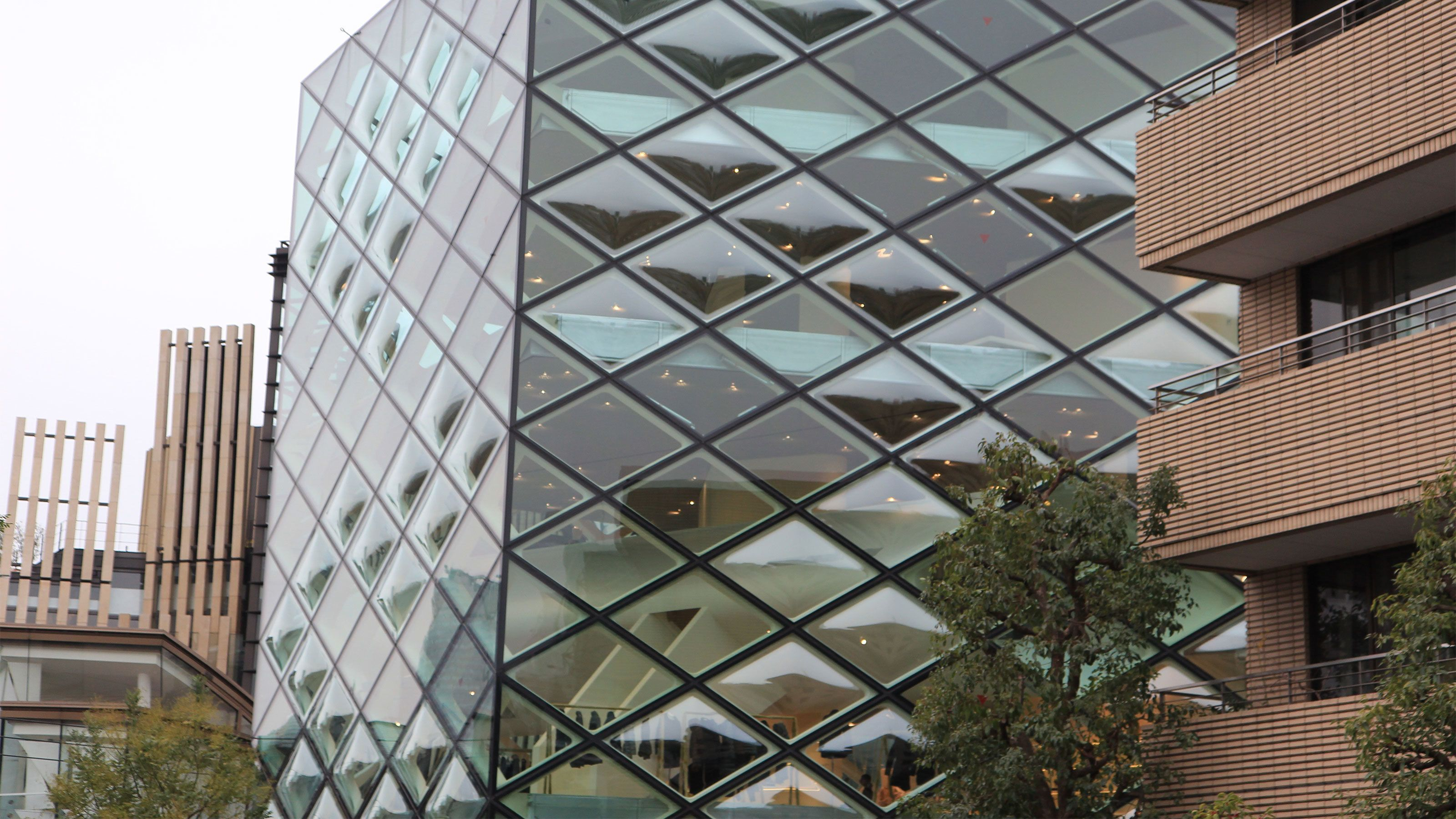 A building with diamond shaped windows in Tokyo Japan