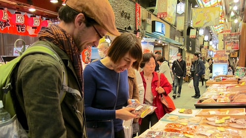 people looking at good at Market in Kyoto