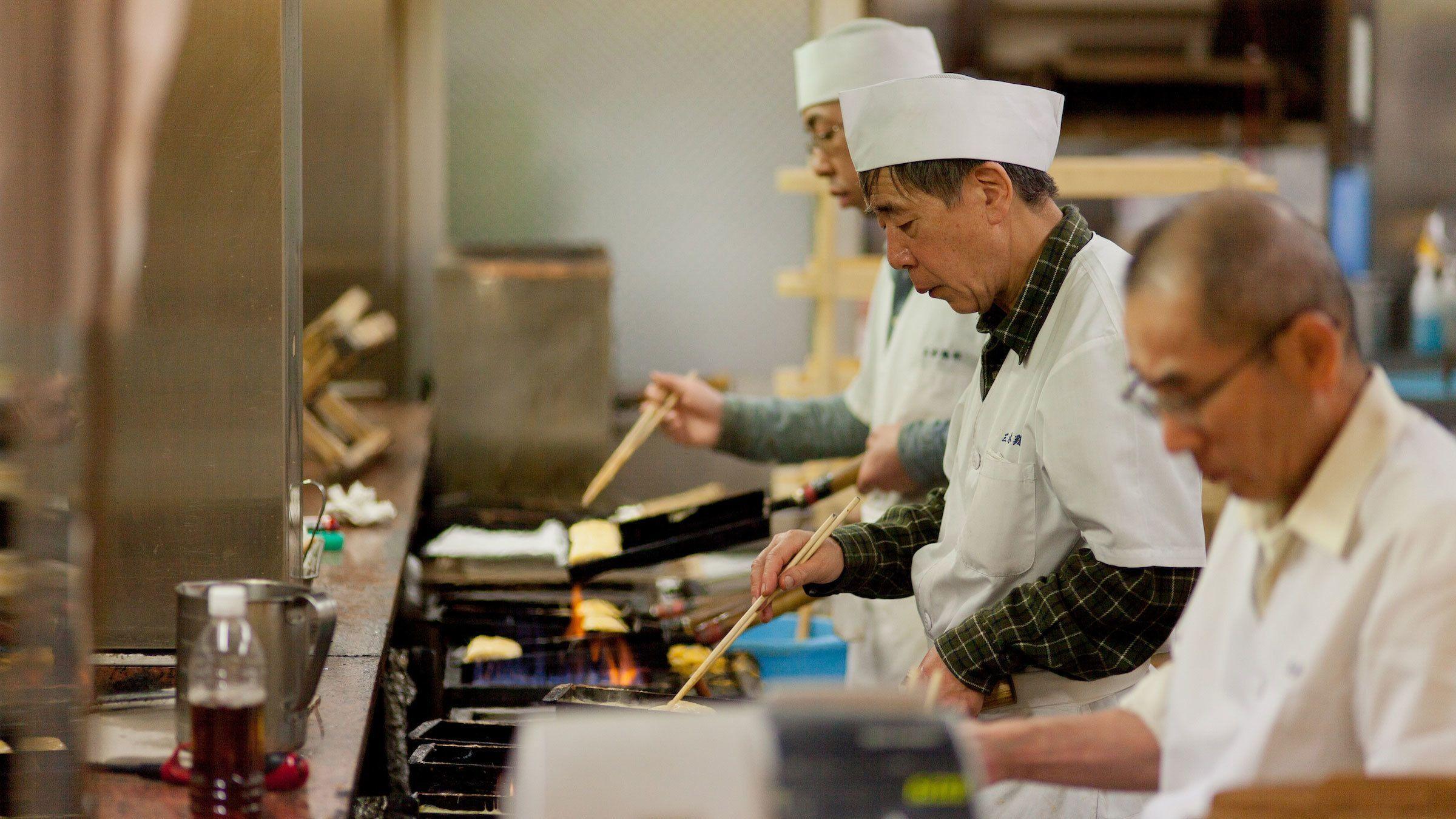 Men cooking at Nishiki Market in Kyoto
