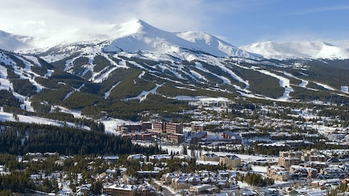 Snow covered mountains towering over Breckenridge