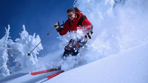 Skier kicking up powder on the slopes in Winter Park