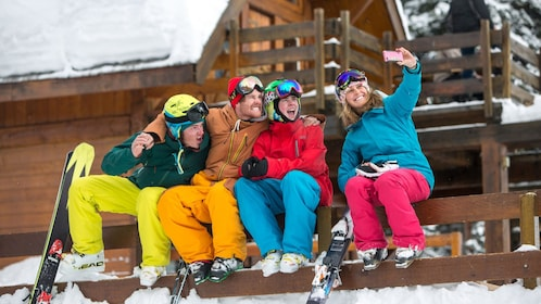 Family of skiers taking a selfie