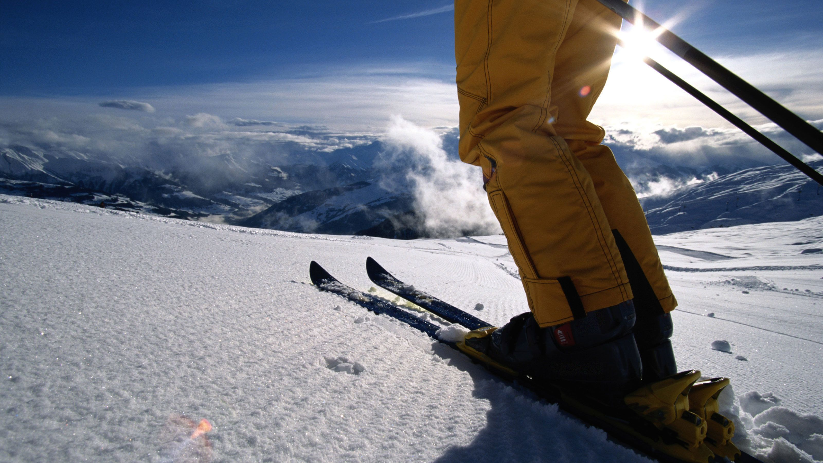 Artistic shot of a skier preparing to traverse the slopes