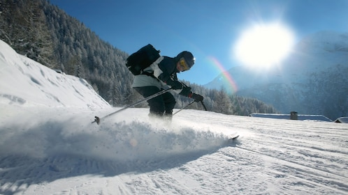 Skier enjoying a sunny day on the slopes of Banff