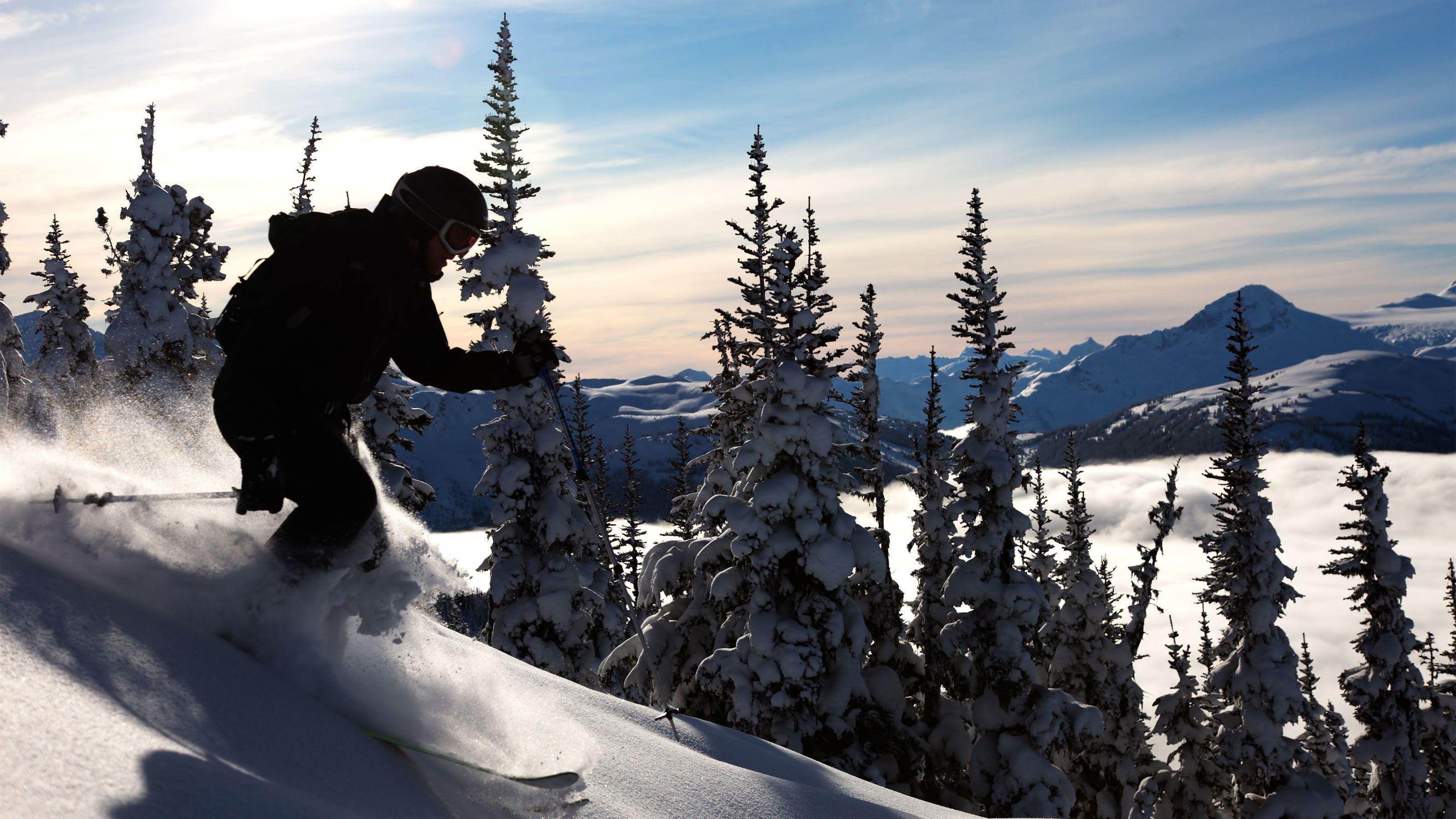 Skier descending the slopes of Banff