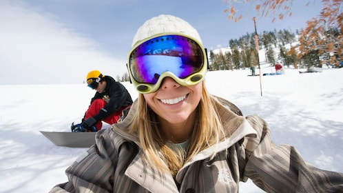 Snowboarder taking a selfie before traversing the slopes