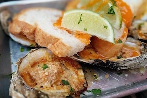 A Traditional Oyster Grilling Experience