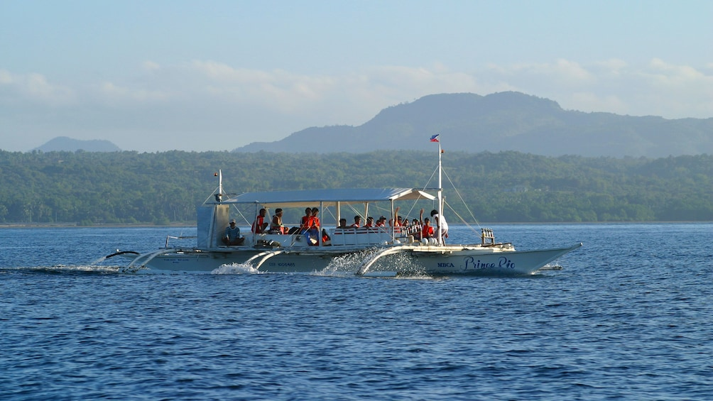 Show item 4 of 5. Group aboard a boat in Bohol