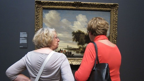 2 women observing painting at museum in Amsterdam
