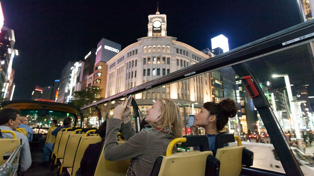 Show item 2 of 5. Girls in top deck of tour bus in Tokyo