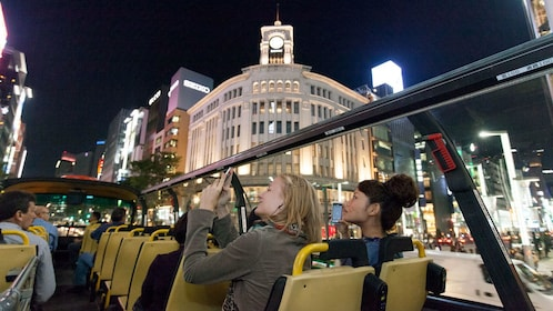 Girls in top deck of tour bus in Tokyo