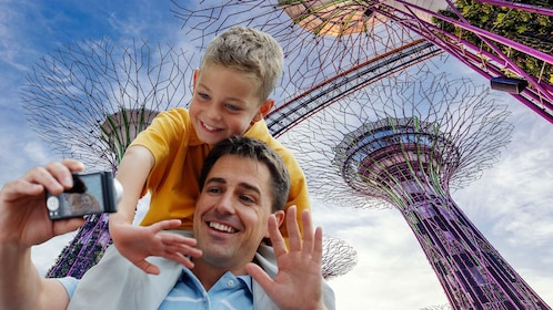 Son on Fathers shoulder at the OCBC Skyway at the Supertree Grove at the Gardens Bay in Singapore