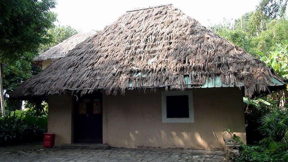 Show item 3 of 5. grass house near shenzhen