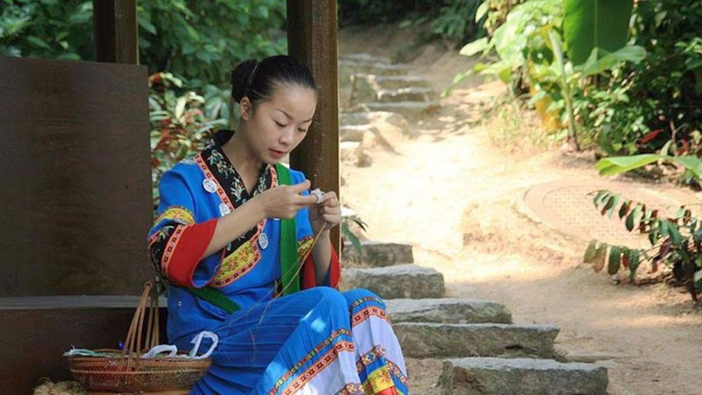 Show item 1 of 5. woman sitting on steps near shenzhen