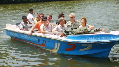 Boating group on a river in Balapitiya