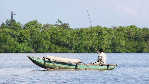 Fisherman on a river in Balapitiya