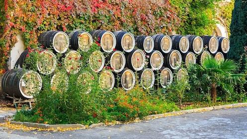 stacked barrels of wine outside in Siena