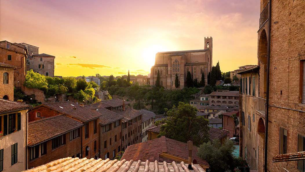 sun setting in the town of Siena