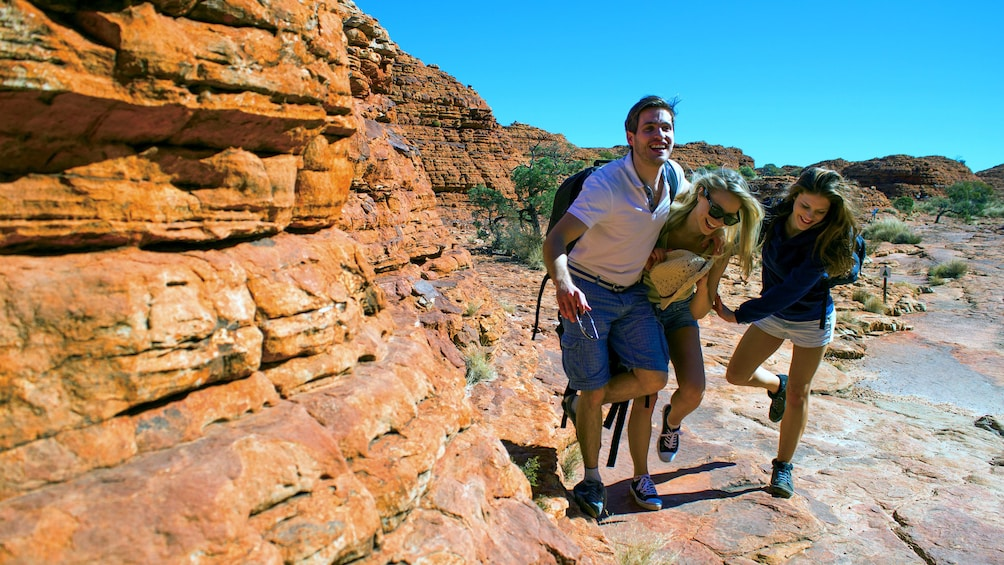Hiking group walking along the rocks of Kings Canyon in Central Australia