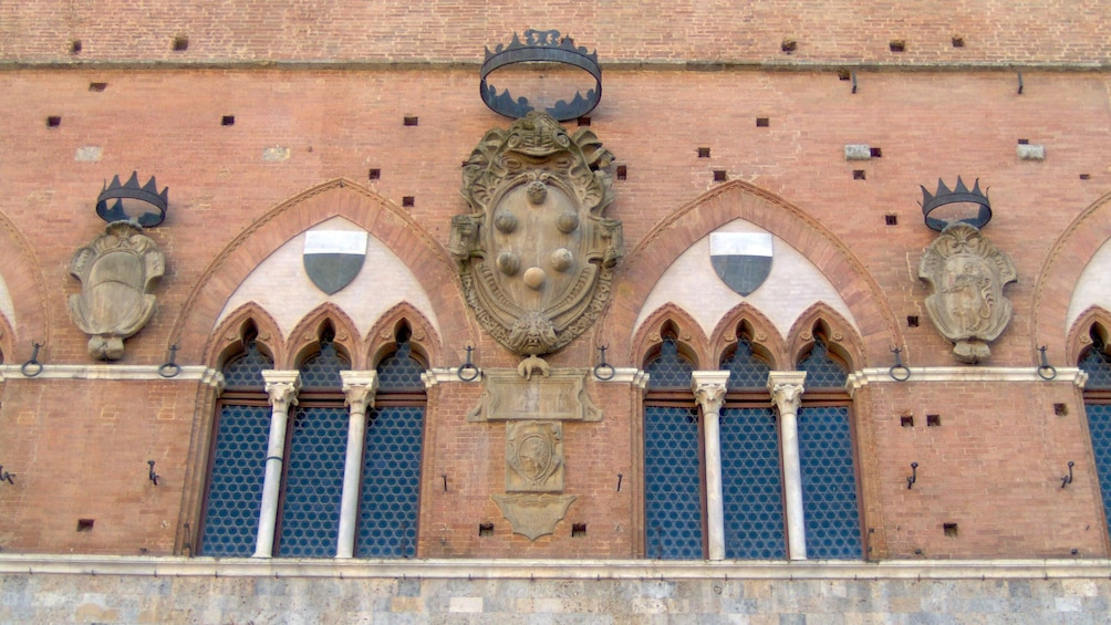 Show item 4 of 10. Ornate building exterior of Highlights of Tuscany tour in Italy